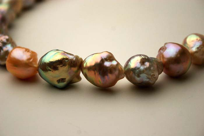 the wild shapes and colors of freshwater ripple pearls