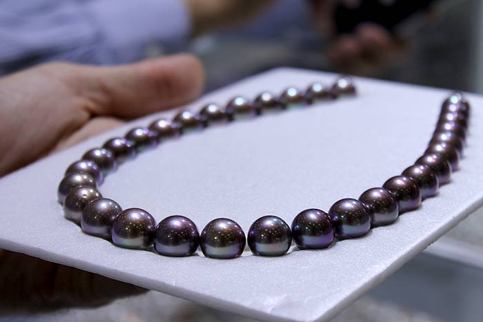 a strand of flawless deep purple Edison pearls