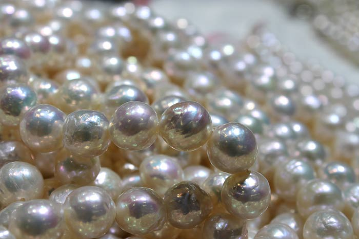 close up of white ripple pearl strands