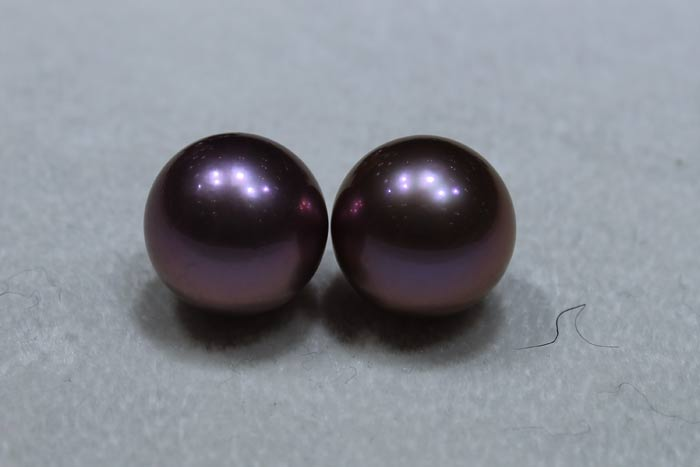 matched pair of deep purple Edison pearls