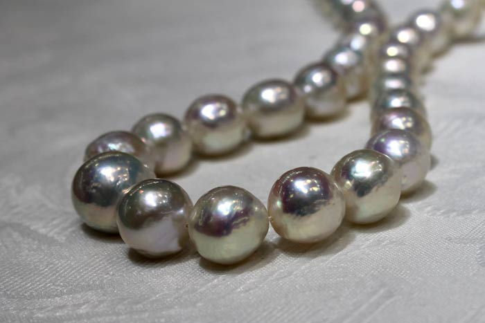 a rope of ripple pearls with metallic luster