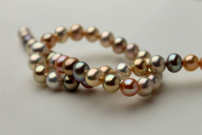 metallic, multi-colored round pearls