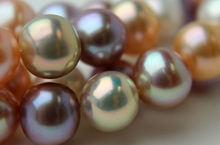 close up of metallic round pearls