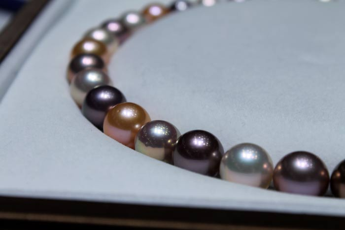 close up of the multicolored metallic pearls