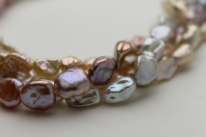 lavender, peach, and silver Keshi on close up
