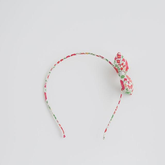 Painted Porcelain Bow Headband