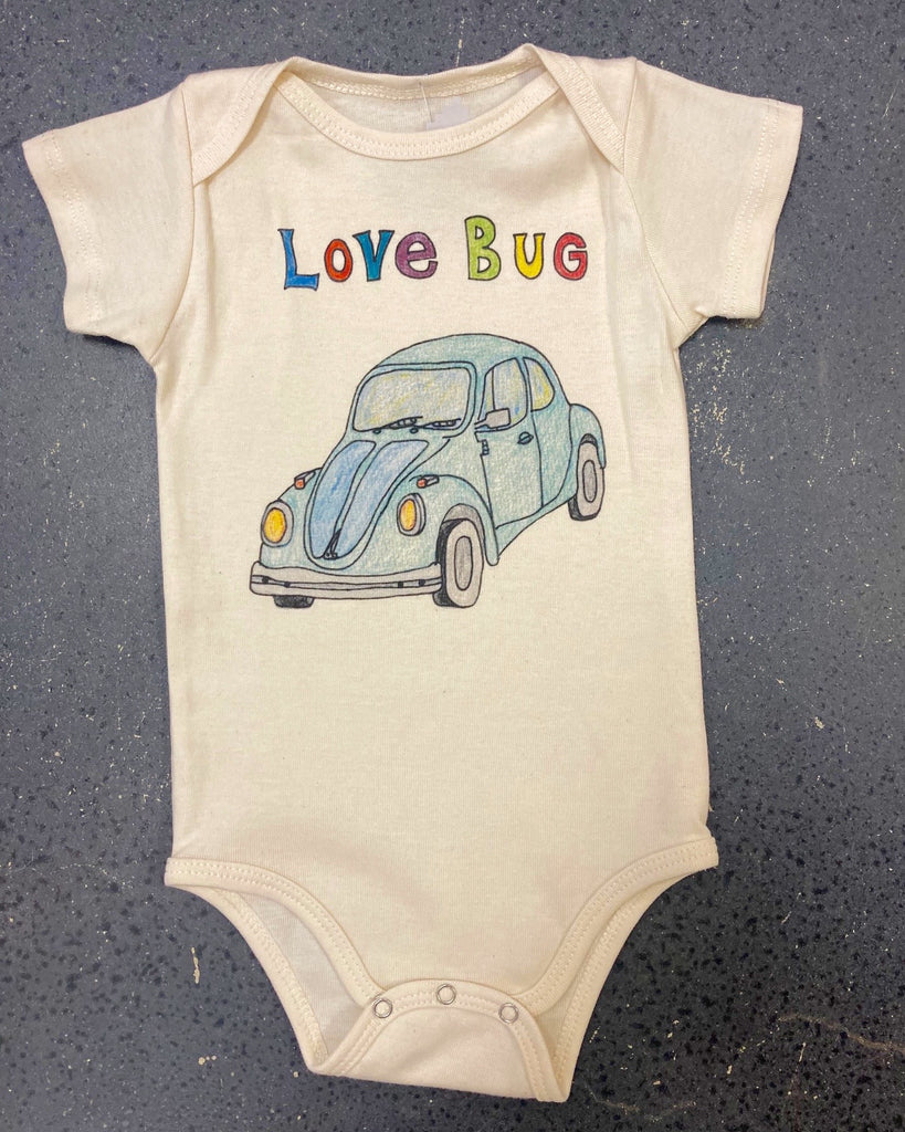 "cream colored baby onesie made from organic cotton with words ""love bug"" and illustration of VW Bug on front"