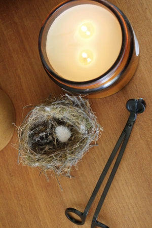 Black wick trimmer with an xl mable + meg candle and a birds nest