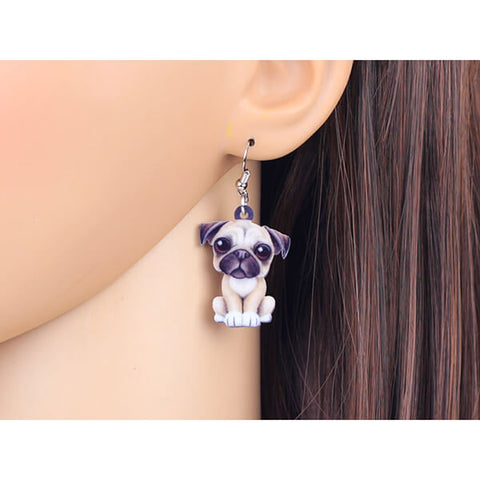 Pug with a pearl earrings