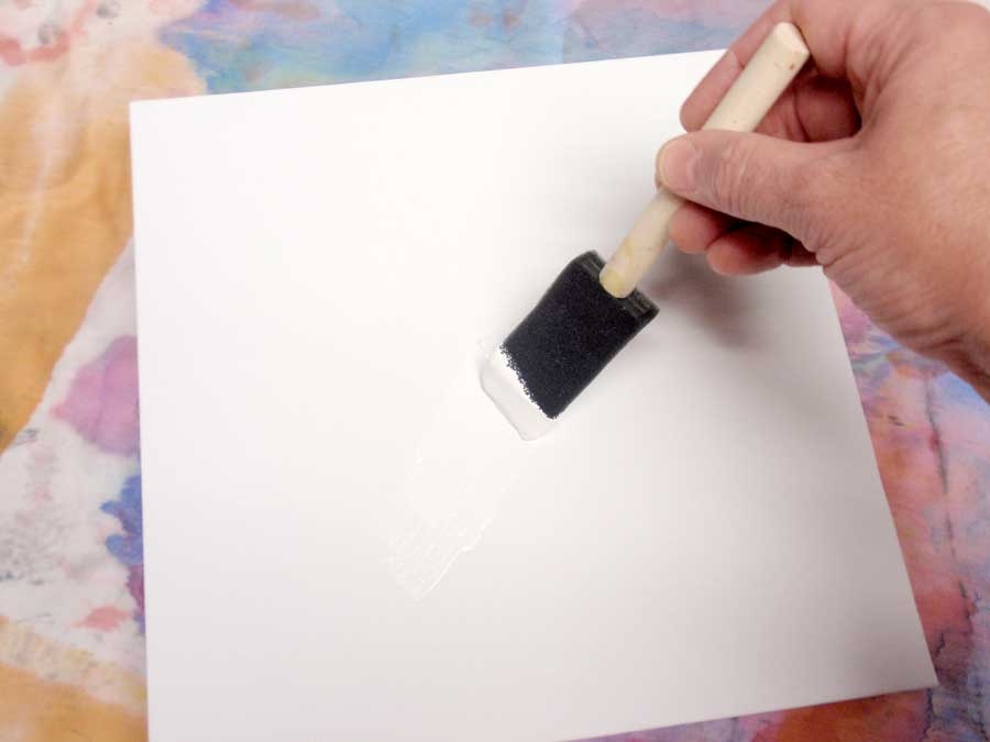 brushing gesso on canvas panel