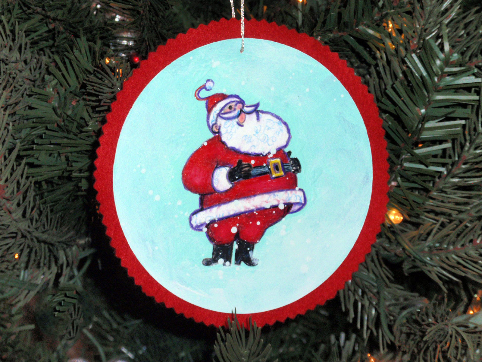 santa ornament hanging on tree