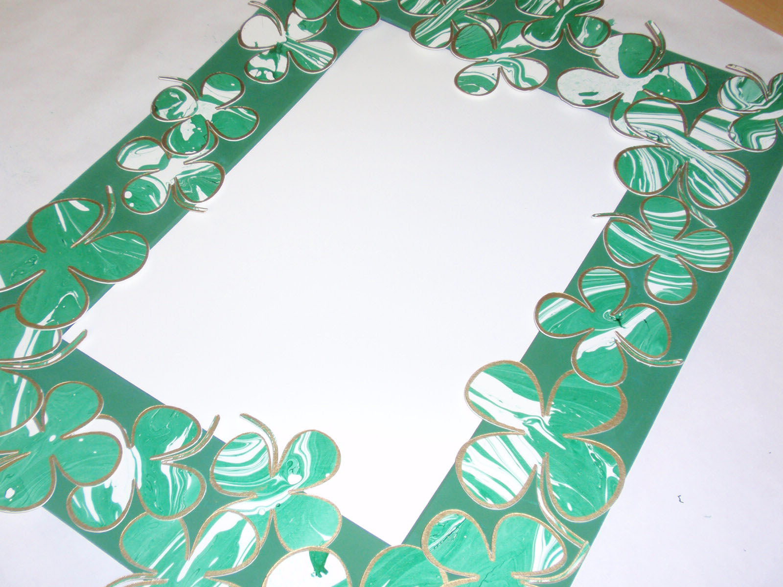 glue shamrocks to mat