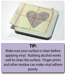 Apply your vinyl to the project surface. Once you have the vinyl stuck to your surface, remove the transfer paper.