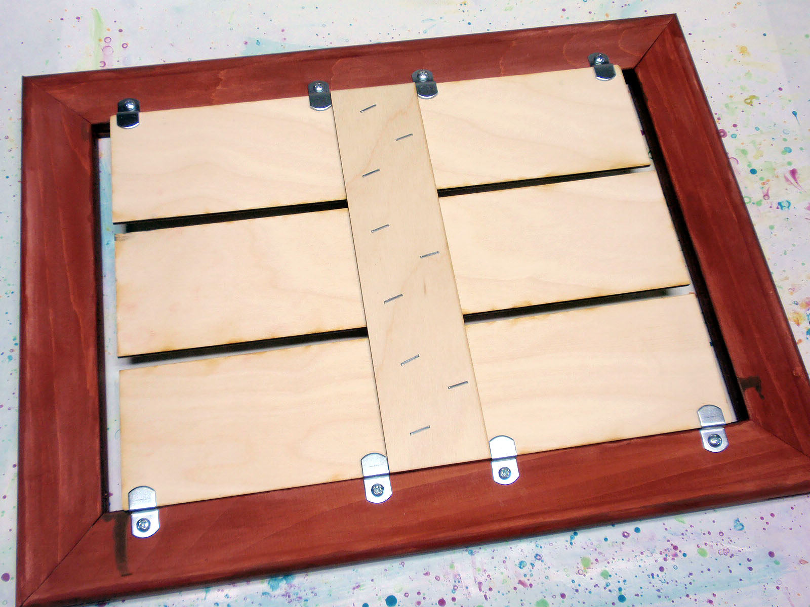 brackets placed to hold pallet
