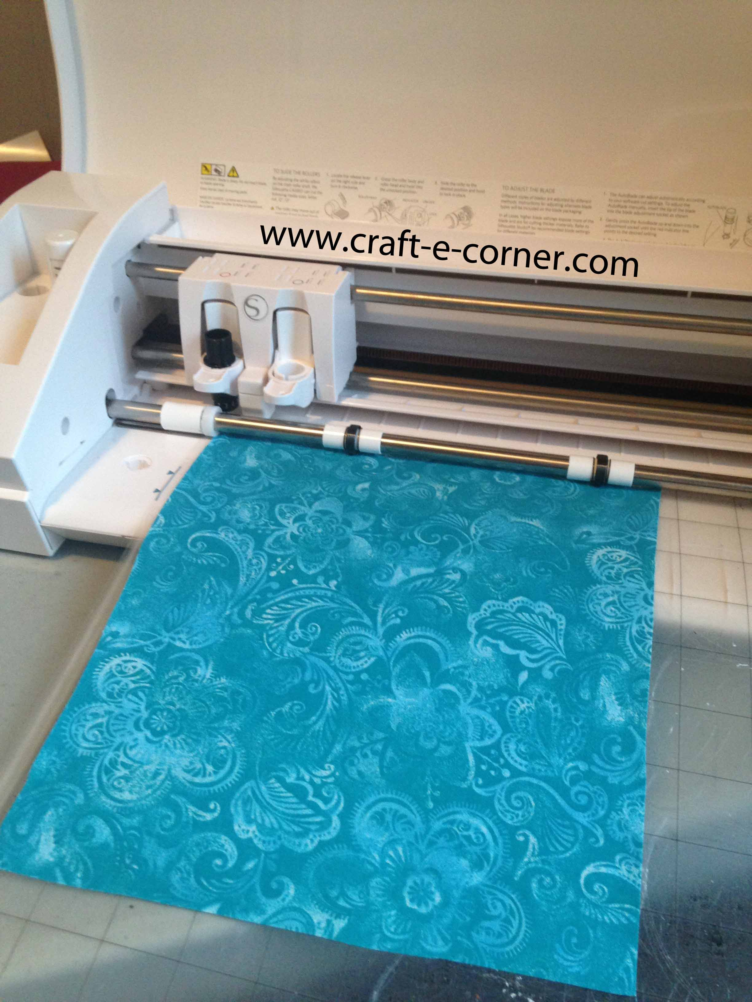 How to cut fabric with the Silhouette Cameo- stabilize fabric and then put on cutting mat, fabric side up.