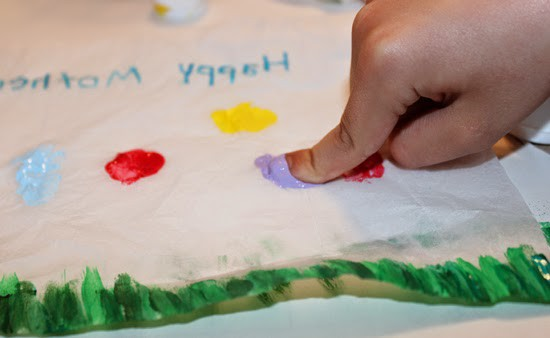 Have your kids use their fingers to paint flowers on the tissue paper for a one of a kind Mother's Day gift!