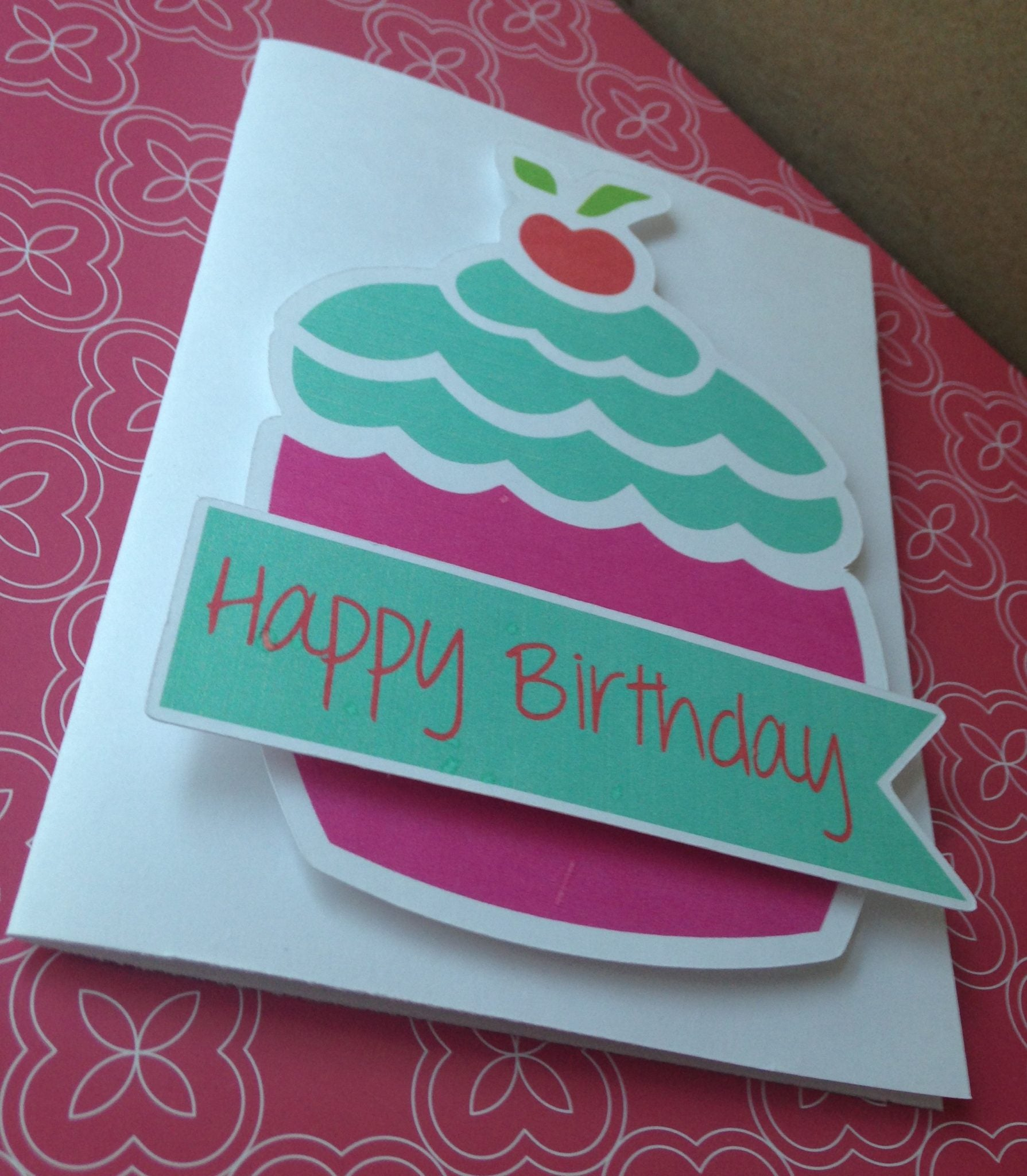 I used the Silhouette Cameo to print and cut my own embellishments and made this cute card in a beat.  So quick and easy and looks so professional!