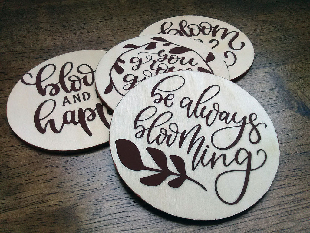 iron-on applied to wood discs