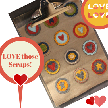 Scrap hearts on clipboard. This looks folk art to me, it could even be used to make a super cute pillow!