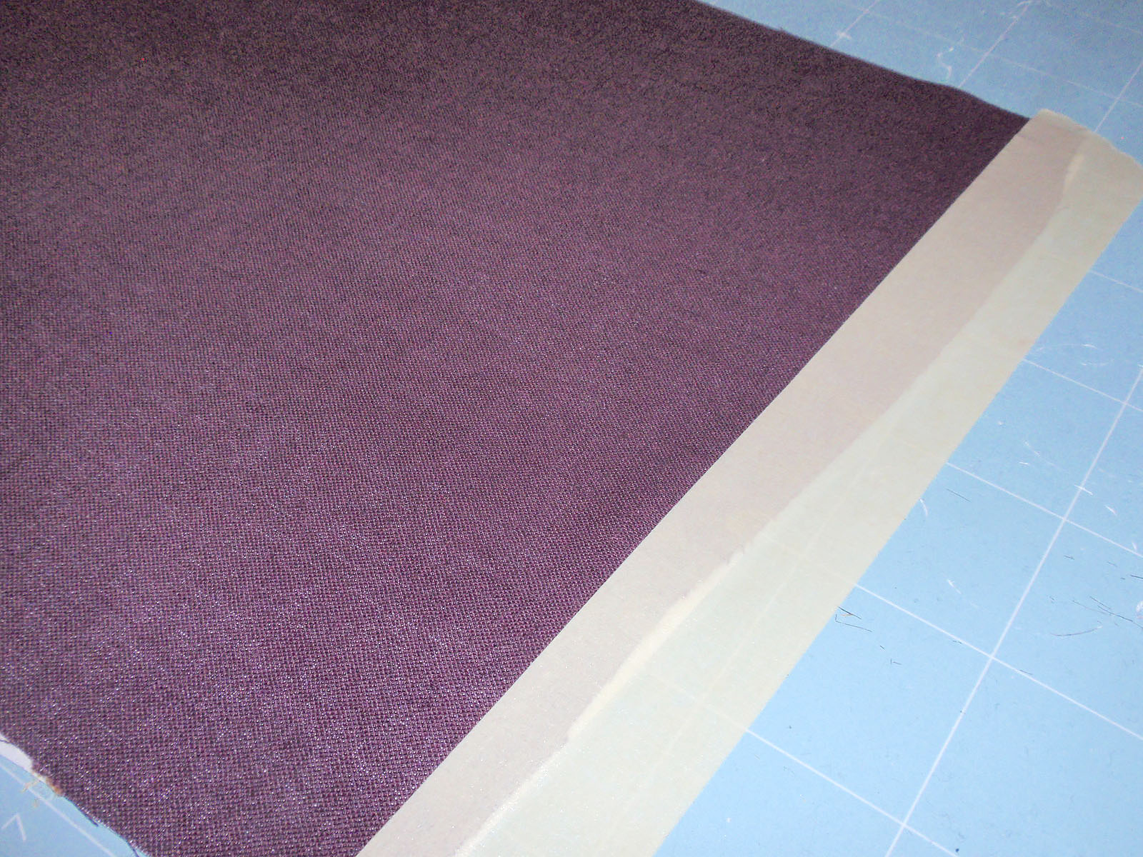 tape fabric to mat