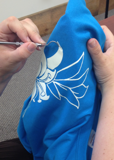 A hook tool will help you get the heat transfer vinyl off the shirt. Be careful, it's hot!