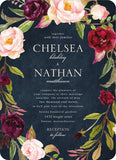 red, blush pink, and plum colored floral printed on a navy paper wedding invitation