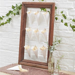 garland wooden frame with 9 white paper cone with string filled with confetti glass vase