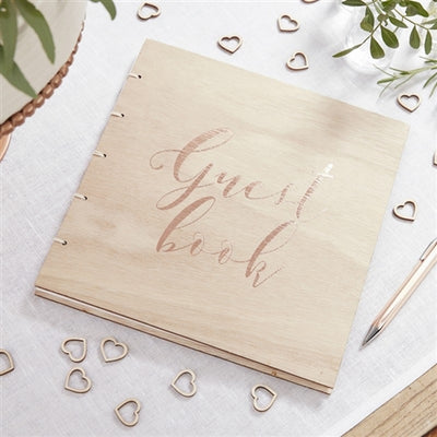 Wooden twine spiral binded book with rose gold text says Guest Book