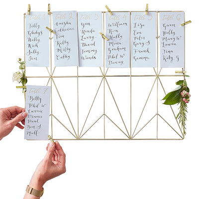 gold wire frame-12 slots for white cards listing table seat plan-hands adding the cards to slots