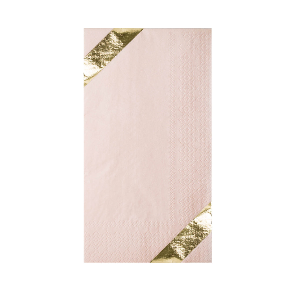 blush pink guest napkin with diagnol printed gold foil stripes on each end