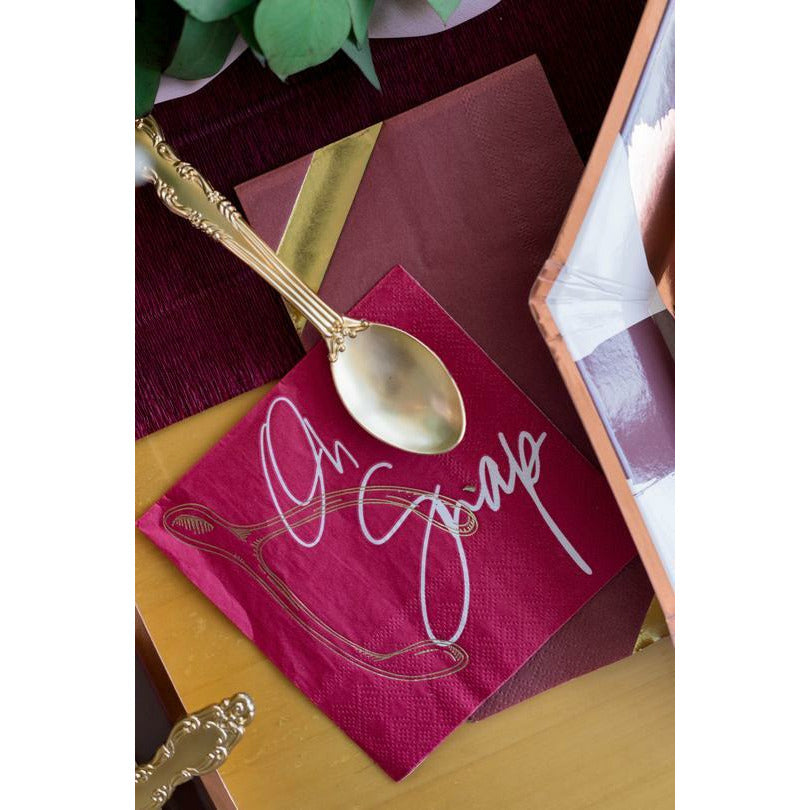pink paper napkin, gold wish bone, white script font says oh snap, gold spoon