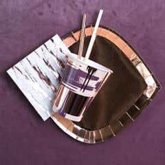 mauve, lilac, taupe, and tan brushstroke pattern, rose gold plate and straw