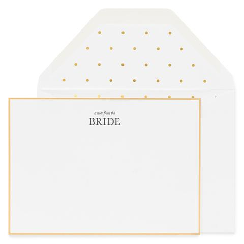 white card gold border black text says from the bride white envelope with white and gold dot liner