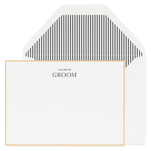 white card gold border black text says from the groom white envelope and white & black striped liner