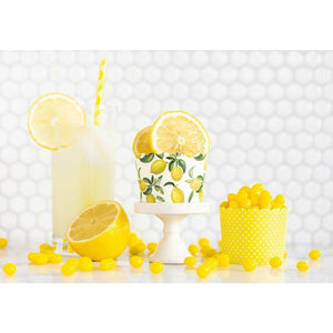 1 yellow & white polka dot treat cup, 1 white treat cup with allover lemon print, glass of lemonade