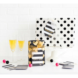 black & white gift tags, black & white polka dot gift box, black & gold gift bag, champagne glasses