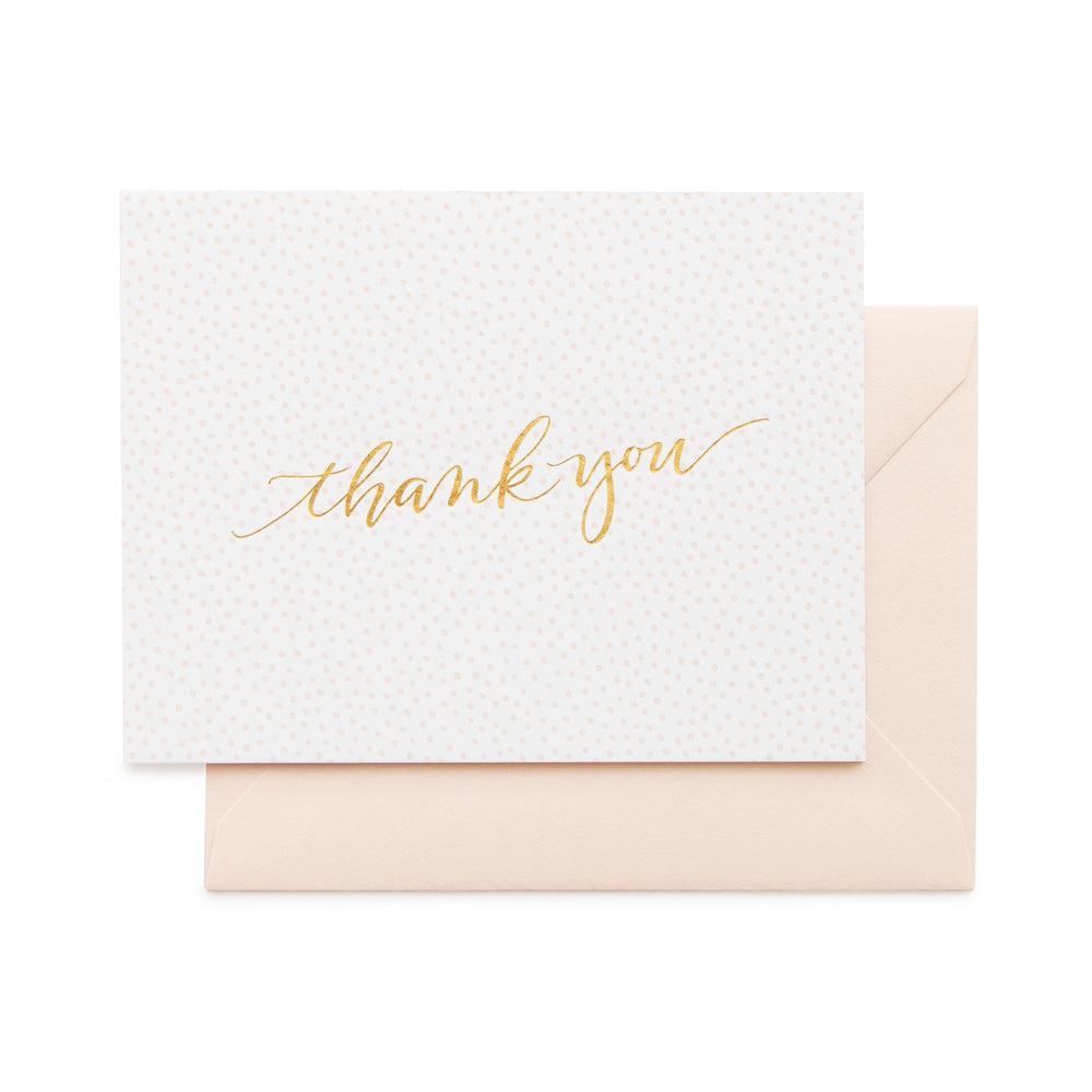 white note card with a printed pink leopard pattern gold text says thank you and a pink envelope