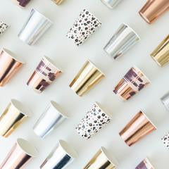 a display of cups - gold foil, rose gold foil, silver foil, cheetah print, mauve marble pattern
