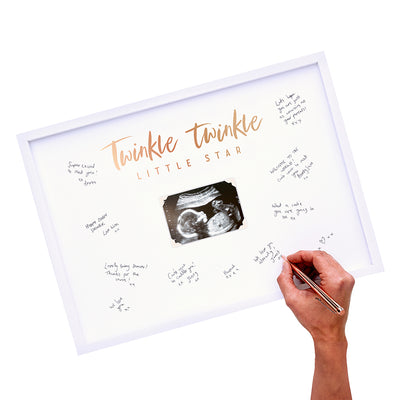 white picture frame with image of a sonogram in the center guest