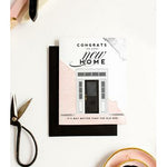 black envelope, white, grey, blush and black card for new home-moving celebration