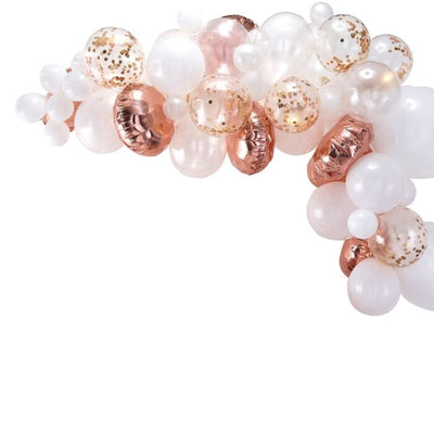 Rose gold, white and confetti filled balloons in an arch