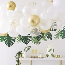 gold, white, & clear confetti balloons hanging from ceiling above a dessert table