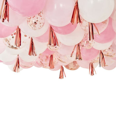 white, pink and rose gold confetti filled balloons, rose gold streamers & tassels