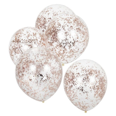 5 clear round balloons filled with rose gold colored confetti
