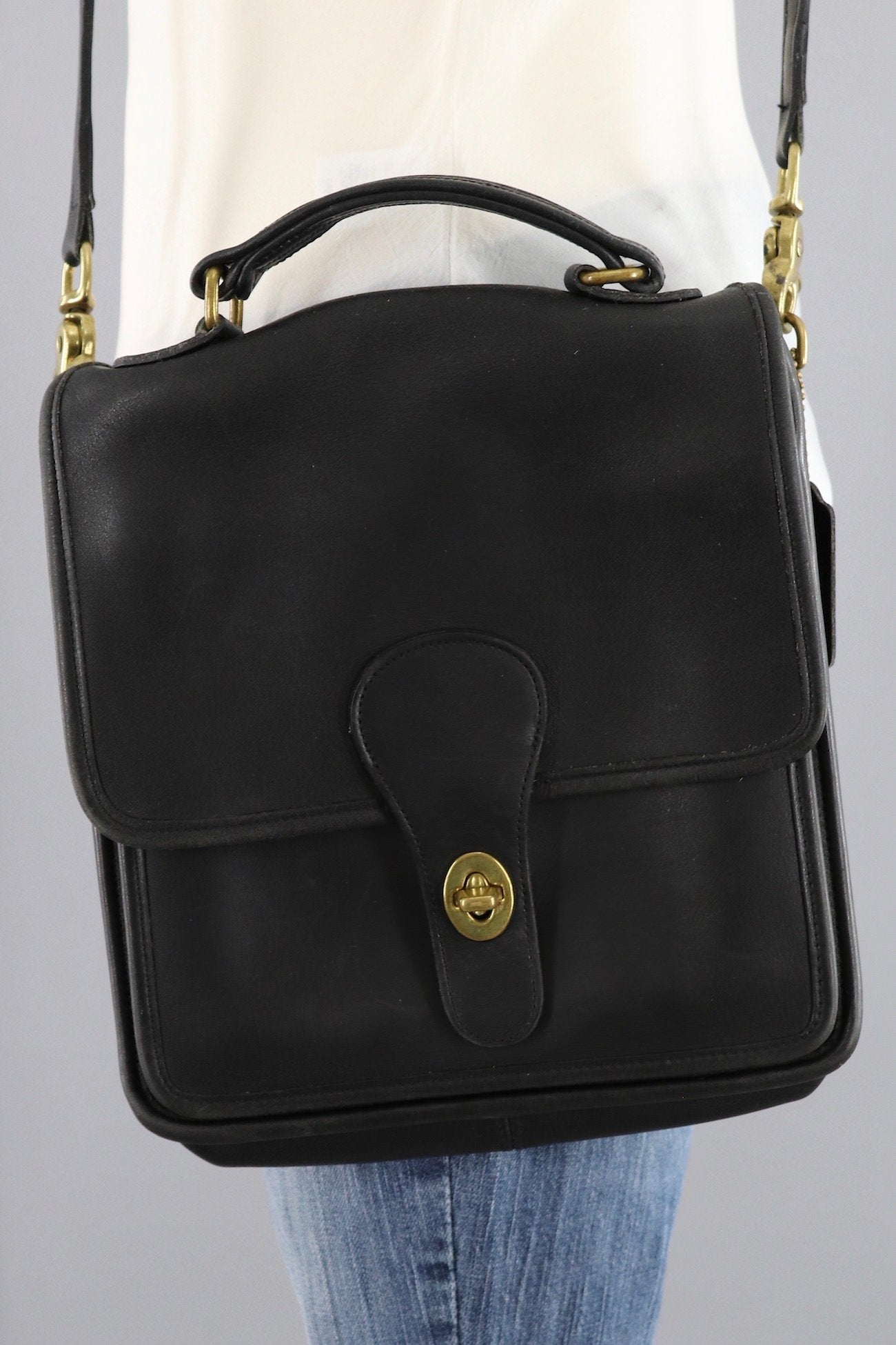 1f71b99314 Vintage coach small messenger bag black leather style a jpg 1300x1950 Leather  small vintage looking suitcase