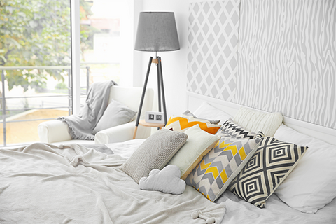 Bedroom Makeover - Bedroom decor with colourful pillows and wallpaper