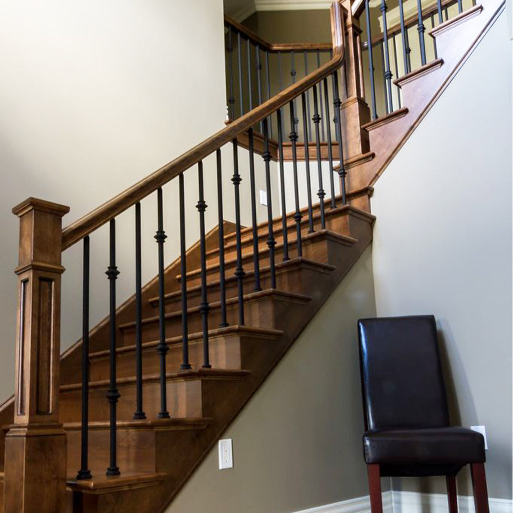 modern contemporary staircase with mega double knuckle wrought iron baluster