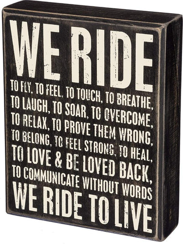We Ride box sign