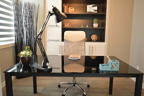 Clean and organized office desk space with accessories and decor