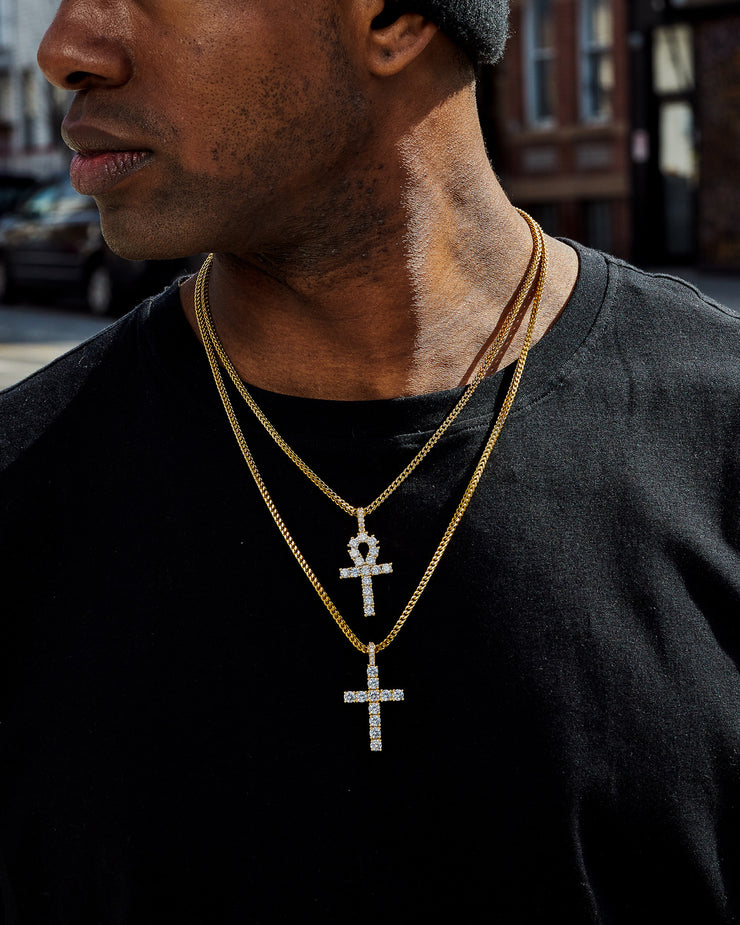 iced out diamond ankh and cross pendant set on franco chains